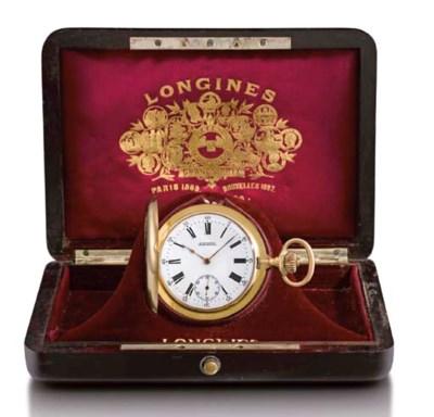 Longines. A fine 18K gold hunt