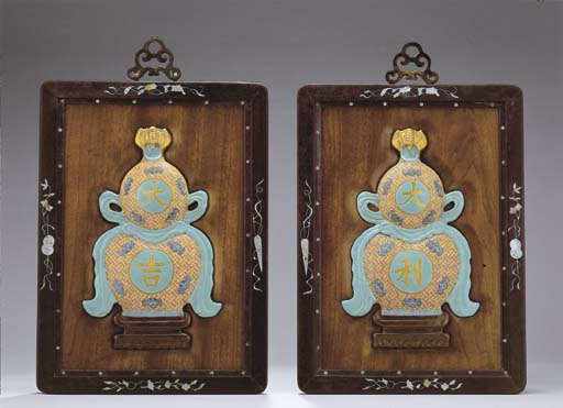 A PAIR OF ENAMELLED CERAMIC DOUBLE-GOURD PLAQUES