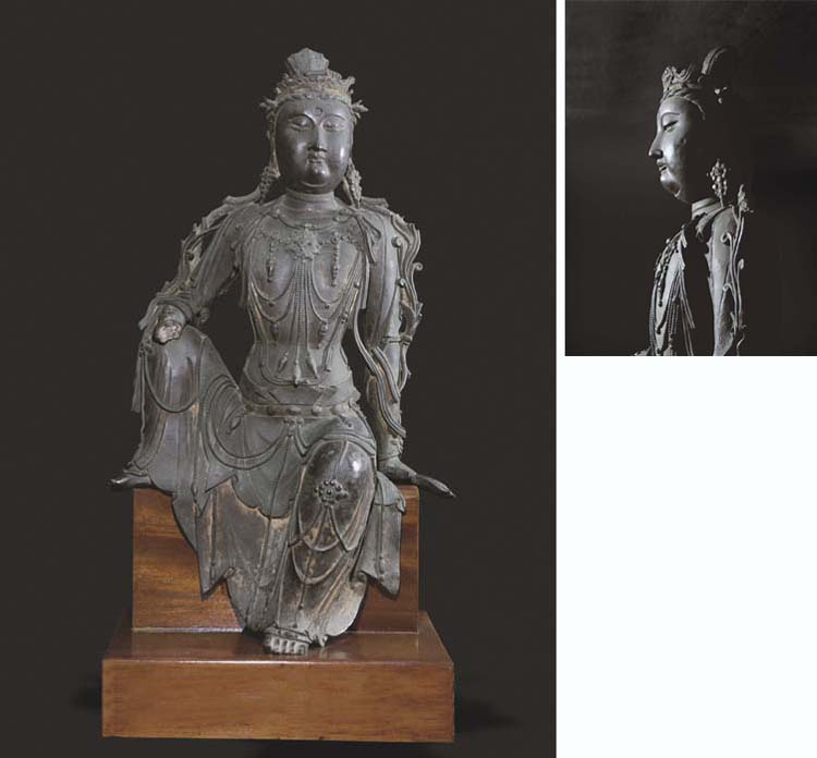 A VERY RARE LARGE BRONZE FIGURE OF GUANYIN