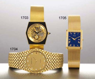 CHATELAIN. AN 18K GOLD AND ONY