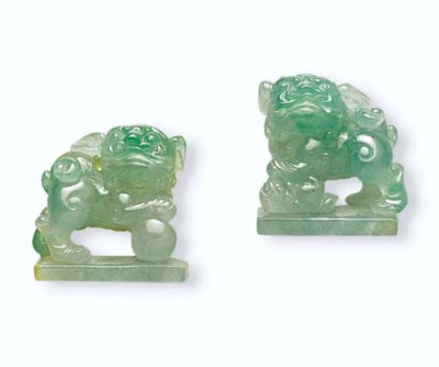 TWO CARVED JADEITE LIONS