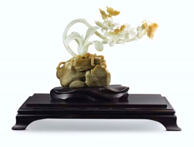 A CARVED NEPHRITE ORCHID