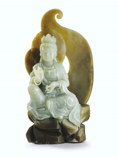 A CARVED NEPHRITE GUANYIN