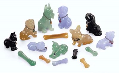 A GROUP OF CARVED JADEITE DOGS