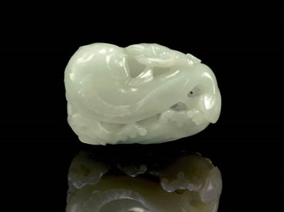 A WHITE JADE CAT-FISH GROUP