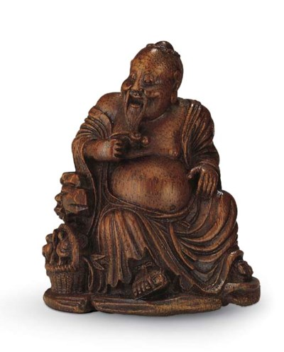 A FINELY CARVED BAMBOO FIGURE