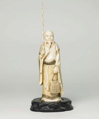 **A JAPANESE IVORY CARVING OF