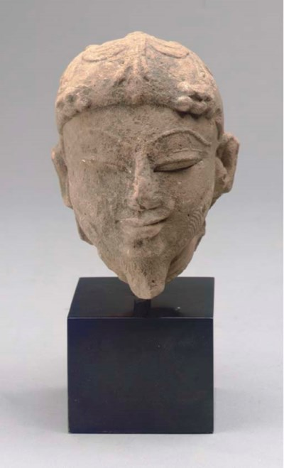 AN INDIAN SANDSTONE HEAD OF A