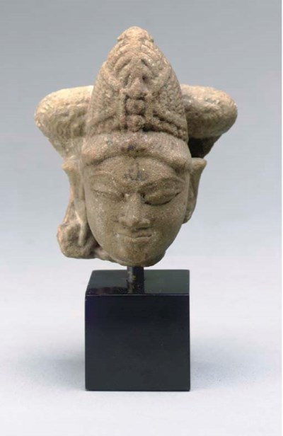 A NORTH INDIAN SANDSTONE HEAD,