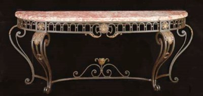 A PARCEL-GILT WROUGHT-IRON AND