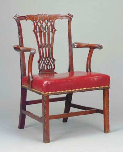 A GEORGE III CARVED MAHOGANY O