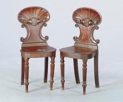 A PAIR OF REGENCY CARVED MAHOG