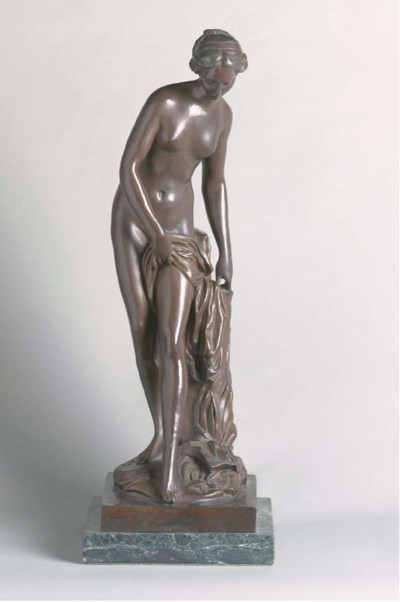 A PATINATED BRONZE FIGURE OF V
