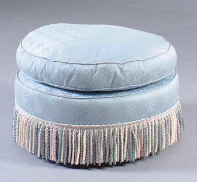 A CIRCULAR UPHOLSTERED POUF CO