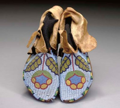 A PAIR OF PLATEAU BEADED HIDE