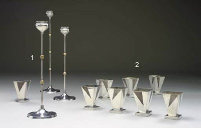 A SET OF EIGHT SILVER-PLATED