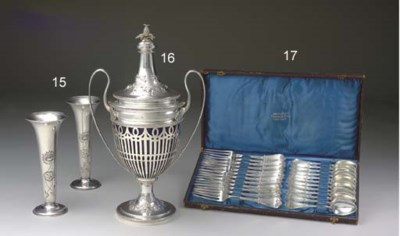 A PAIR OF SILVER VASES