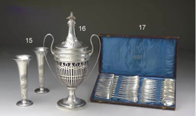 A SILVER TWO-HANDLED CUP AND C