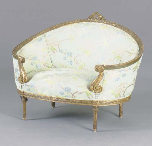 A LOUIS XVI STYLE GILTWOOD CAN