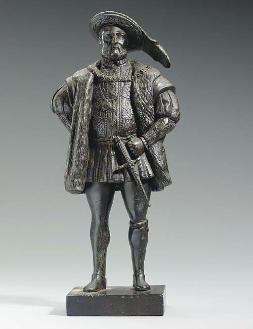 A PATINATED-BRONZE FIGURE OF H