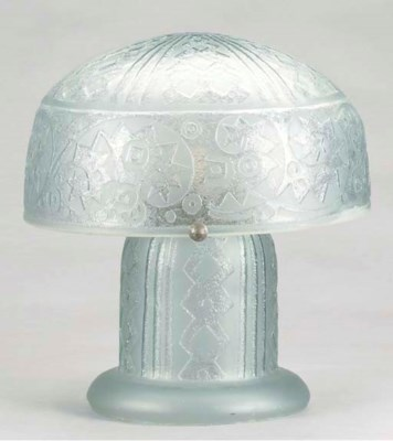 AN ART DECO STYLE CARVED AND E