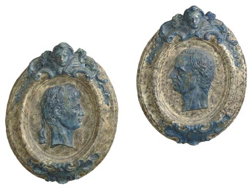 A PAIR OF PAINTED PLASTER OVAL
