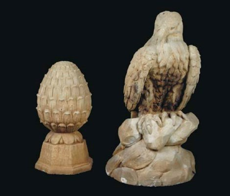 A PAIR OF CAST-STONE EAGLES TO