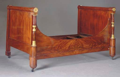 AN EMPIRE MAHOGANY AND GILT-BR