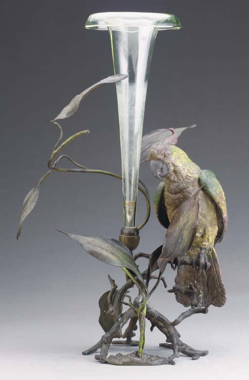 A TRUMPET-FORM GLASS VASE WITH
