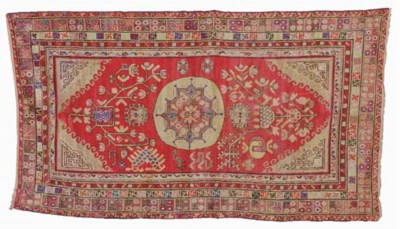AN EAST TURKESTAN CARPET,