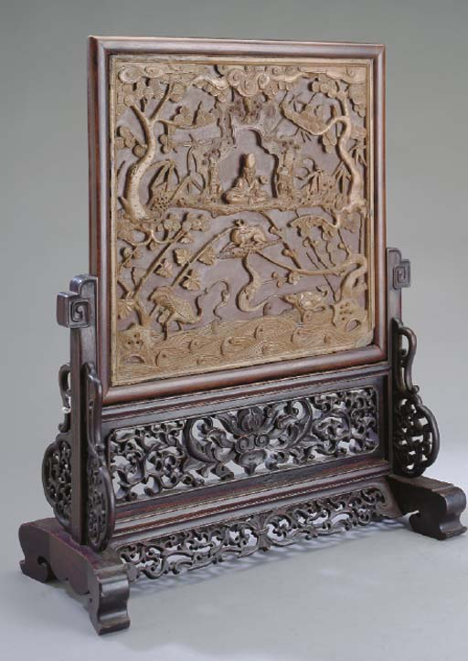 A CHINESE CARVED DUAN STONE SC