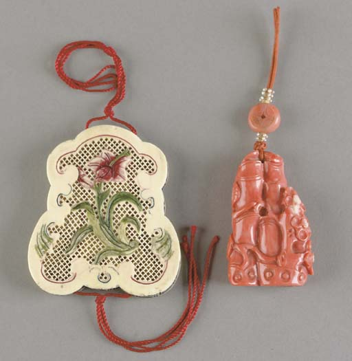 A CHINESE CARVED CORAL PENDANT