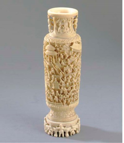 A CARVED IVORY VASE AND STAND*