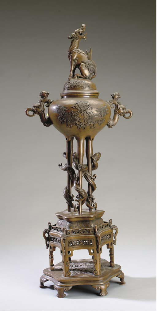 A JAPNESE BRONZE TALL COVERED