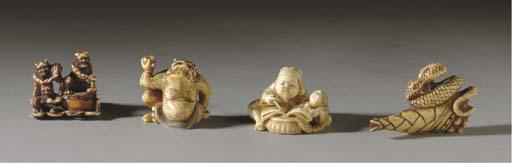 FOUR JAPANESE IVORY NETSUKE**,