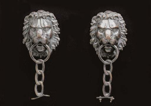 A PAIR OF PATINATED BRONZE LIO