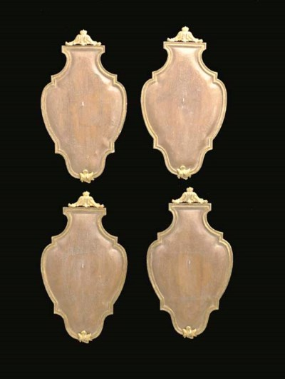 A SET OF FOUR PARCEL-GILT AND