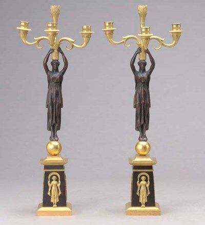 A PAIR OF EMPIRE STYLE GILT AN