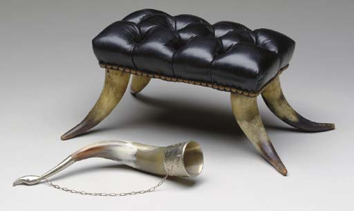 A GROUP OF THREE HORN TABLE IT