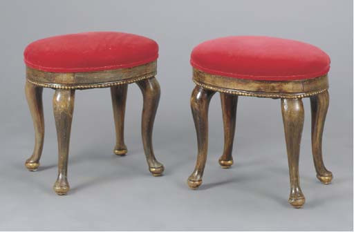 A PAIR OF CRIMSON UPHOLSTERED