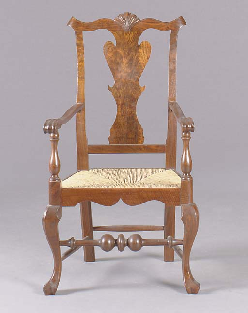 A CHIPPENDALE STYLE CARVED MAHOGANY OPEN ARMCHAIR,