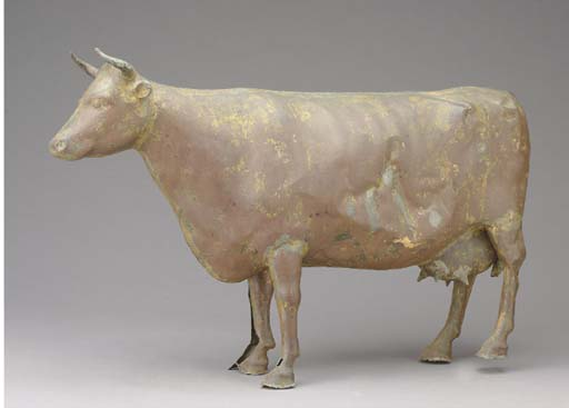 A MOLDED COPPER COW,