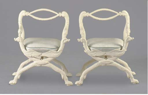 A PAIR OF CAST IRON CURULE-FOR