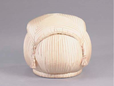 AN UPHOLSTERED POUF,