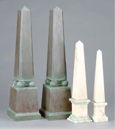 A PAIR OF PATINATED-METAL OBEL