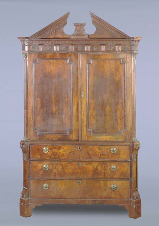 A DUTCH MAHOGANY AND GILT- BRO
