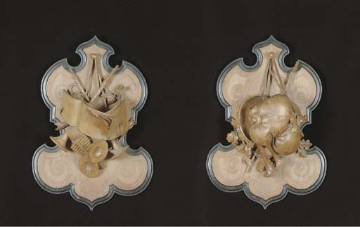 A PAIR OF CARVED WOOD TROPHY S