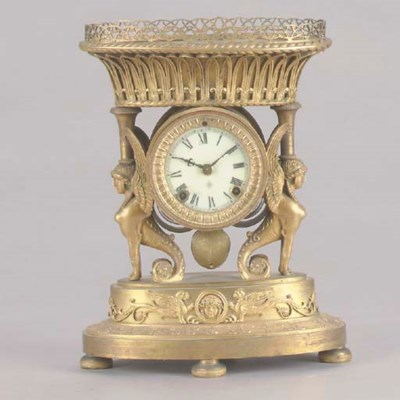 AN EMPIRE STYLE GILT-BRONZE MA