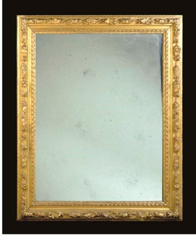 A GILT COMPOSITION WALL MIRROR