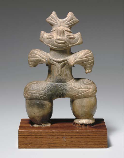 An Earthenware Figure of a Wom